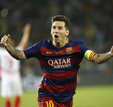 Barcelona's Lionel Messi celebrates a goal scored by his teammate Pedro Rodriguez during their UEFA Super Cup soccer match against Sevilla at Boris Paichadze Dinamo Arena in Tbilisi