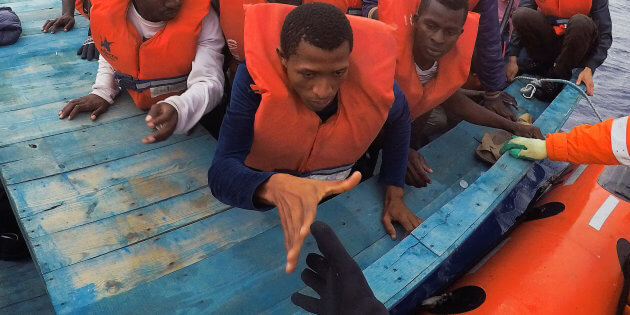 "Migrants on wooden boat being rescued by ""Save the Children"" NGO crew from the ship Vos Hestia in the Mediterranean sea off Libya coast"