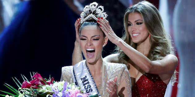 Miss South Africa Demi-Leigh Nel-Peters reacts as she is crowned by Miss Universe 2016 Iris Mittenaere during the 66th Miss Universe pageant at Planet Hollywood hotel-casino in Las Vegas