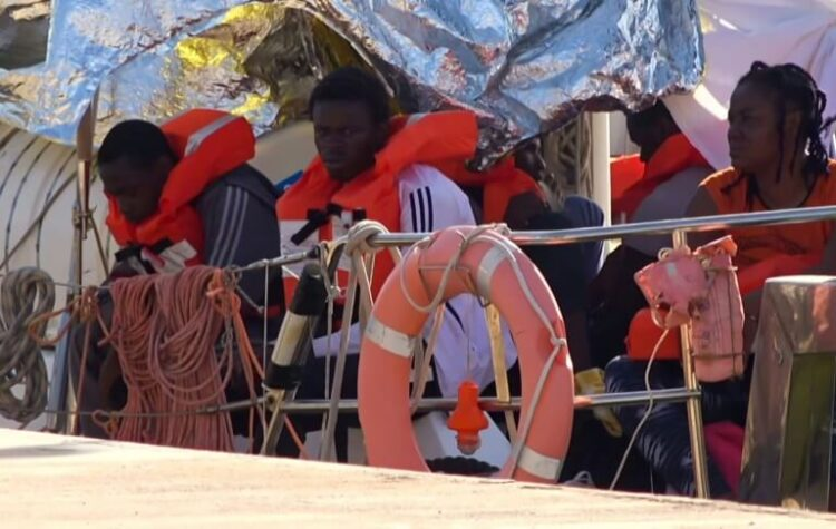 Des migrants en Italie